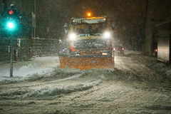 Snowfall on the streets of Velika Gorica, Croatia. VELIKA GORICA, CROATIA - JANUARY 13th, 2017 : Snowplow cleaning streets in the aggravated traffic due to Royalty Free Stock Images