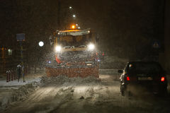 Snowfall on the streets of Velika Gorica, Croatia. VELIKA GORICA, CROATIA - JANUARY 13th, 2017 : Snowplow cleaning streets in the aggravated traffic due to stock images
