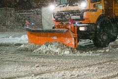 Snowfall on the streets of Velika Gorica, Croatia. VELIKA GORICA, CROATIA - JANUARY 13th, 2017 : Snowplow cleaning streets in the aggravated traffic due to Royalty Free Stock Image
