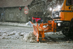 Snowfall on the streets of Velika Gorica, Croatia. VELIKA GORICA, CROATIA - JANUARY 13th, 2017 : Snowplow cleaning streets in the aggravated traffic due to Stock Image