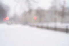 Snowfall in town with blurred moving cars on background Stock Photography