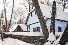Snowfall on traditional old houses in a Romanian Village. Snowfall on traditional old houses in winter at the Village Museum in Bucharest, Romania Royalty Free Stock Photos