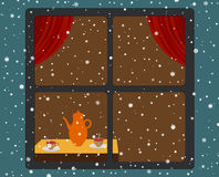 Snowfall and warm room Stock Image