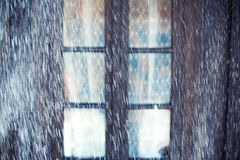 Snowfall and window Royalty Free Stock Photos