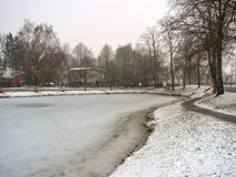 Snowfall on winter lake in the Dutch city Heerlen. Royalty Free Stock Photography