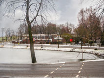 Snowfall on winter lake in the Dutch city Heerlen. Royalty Free Stock Photos