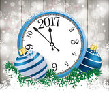 Snowfall Woo Blue Baubles Clock 2017. Snow with blue baubles and clock on the wooden background Stock Images