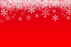 Snowfalling на красном цвете Стоковая Фотография