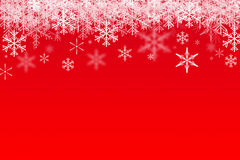 Snowfalling on red Stock Photography