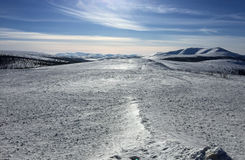 Snowfield with mountain Stock Image