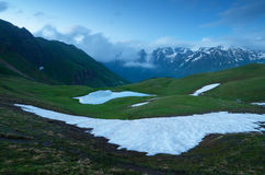 Snowfield in the mountains stock photo