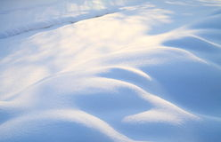 Snowfield. Outside a small peaceful village in northeast of China, the sun is shining after a heavy snow. The ground is covered by snow stock photo