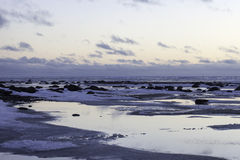 Snowfield and water scenery of early spring on big lake Royalty Free Stock Photography