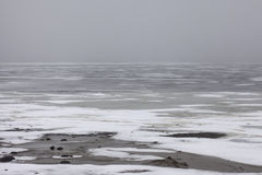 Snowfield winter scenery on big lake Royalty Free Stock Images