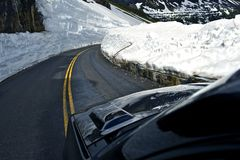 Snowfields. Road Through Glacier National Park in Montana, USA. Mountain Road Stock Photography