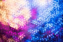 Snowflake που διαμορφώνεται ανάβει bokeh Στοκ Εικόνες