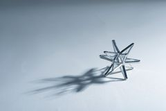 Snowflake. Abstract snowflake with snowflake shadow; grey blue tone stock photos