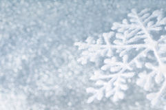 Snowflake. On grey shiny background royalty free stock image