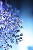 Snowflake. Plastic snowflake on blue background Royalty Free Stock Photo