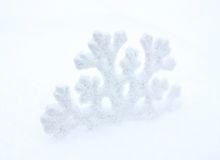 Snowflake. White snowflake, in white snow. Winter royalty free stock photography