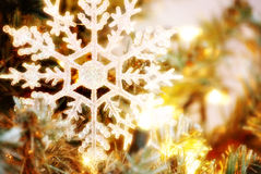 Snowflake. Christmas tree ornament with lights Royalty Free Stock Photo