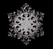 Snowflake. Shape, photo on the black background Royalty Free Stock Image