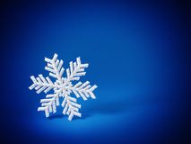 Snowflake. Beautiful white snowflake on blue background royalty free stock image