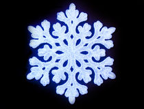 Snowflake. Reproduction of blue snowflake on black background Royalty Free Stock Images