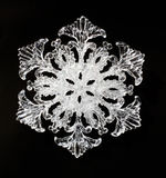 Snowflake. Glass snowflake on black background Royalty Free Stock Image