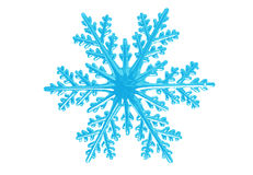 Snowflake. Isolated plastic snowflake on white background stock image