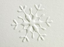Snowflake. Embosed snowflake shape on paper Royalty Free Stock Photography