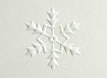 Snowflake. White embossed paper snowflake design Stock Photos