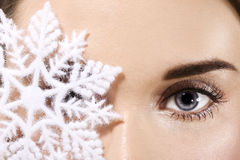 Snowflake. Woman eye with snowflake closeup royalty free stock images