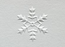 Snowflake. White embossed paper snowflake design Royalty Free Stock Images