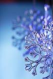 Snowflake. Christmas snowflake on blue background Royalty Free Stock Photo