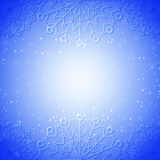 Snowflake abstract blue background. With glow and snowfall Royalty Free Stock Image