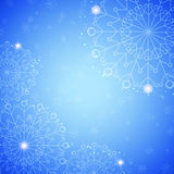 Snowflake abstract blue background. With glow and snowfall Stock Photo