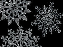 Snowflake Background 03. Metallic silver snowflakes on a black background Royalty Free Stock Images