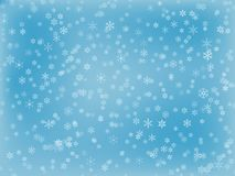 Snowflake Background. A light blue snowflake background with different snowflakes Stock Photos