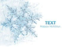 Snowflake background. Beautiful blue snowflake isolated, winter holiday background with copy space royalty free stock image