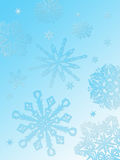 Snowflake background-aqua. A gradient aqua background with various sizes and styles of snowflakes descending into the foreground Stock Photo