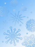 Snowflake background-blue. A gradient background in sky blue with snowflakes in various sizes and styles descending into the foreground Royalty Free Stock Photography