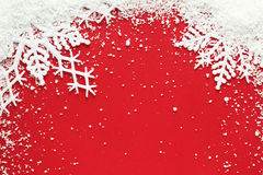 Snowflake background. Snowflake and snow on red background royalty free stock photography