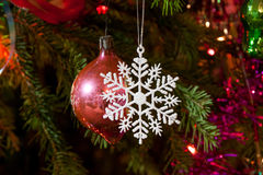 Snowflake and the ball hanging on  Christmas tree Royalty Free Stock Photography