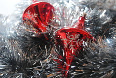 Snowflake on bauble 3. Silver snowflake on red Christmas bauble resting in silver tinsel Royalty Free Stock Photos