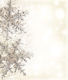 Snowflake beige decorative border. Christmas holiday background with big beautiful snowflake, Christmas tree ornament and decoration, beige card made of abstract Royalty Free Stock Photo