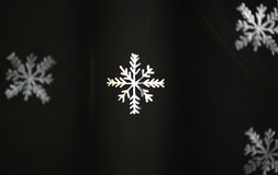 Snowflake on black paper Royalty Free Stock Image