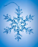 Snowflake on blue background. One snowflake on blue background Royalty Free Stock Photo