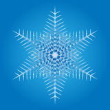 Snowflake on a blue background Stock Photos
