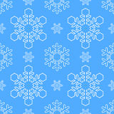 Snowflake on Blue Background Seamless Pattern Royalty Free Stock Photography